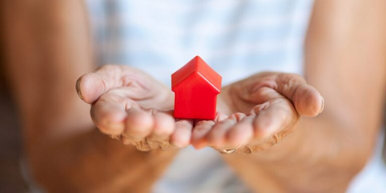 Woman holding miniature house