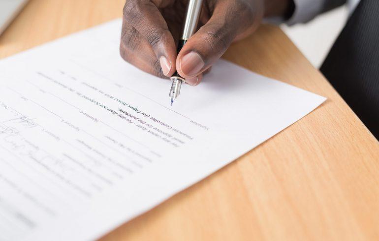 Man writing legal document